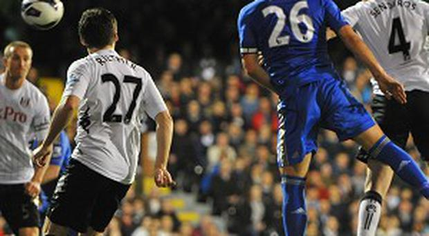 John Terry, second right, heads home for Chelsea in their victory over west London rivals Fulham