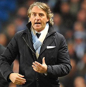 Roberto Mancini paid tribute to opponents Wigan after Manchester City's win