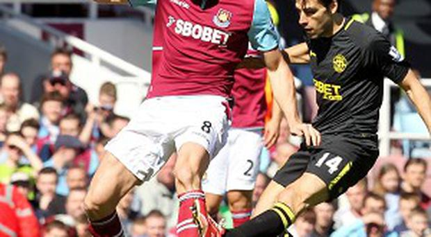 Andy Carroll, left, has contributed two assists and three goals in West Ham's last four matches