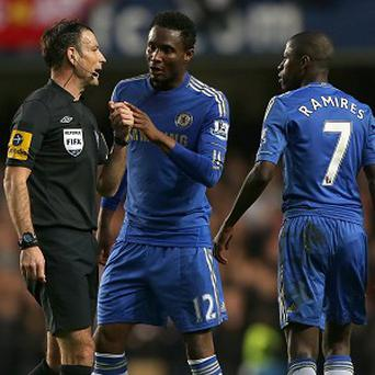 Mark Clattenburg, left, has not officiated at Chelsea since a row involving John Obi Mikel