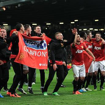 Robin van Persie, far right, joins his Manchester United team-mates in celebration