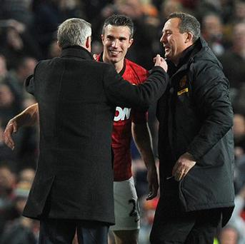 Sir Alex Ferguson, left, lauded Robin Van Persie's influence on the title-winning campaign