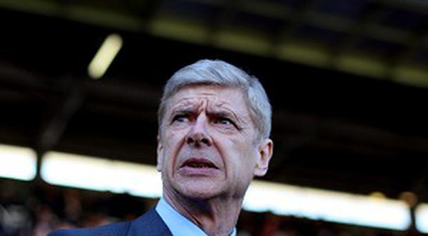 Arsenal Manager Arsene Wenger has admitted losing Olivier Giroud for the visit of Manchester United is a 'blow'