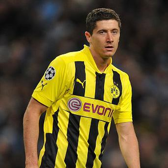 Robert Lewandowski was on target twice for Broussia Dortmund in their 3-0 victory over Marseille