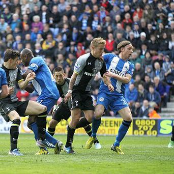 Emmerson Boyce, third left, scored Wigan's first-half equaliser before netting an own goal