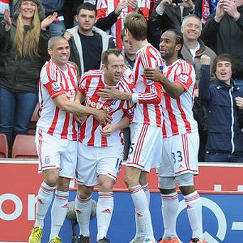 Charlie Adam, second left, netted just after the break as Stoke claimed a much-needed victory over Norwich