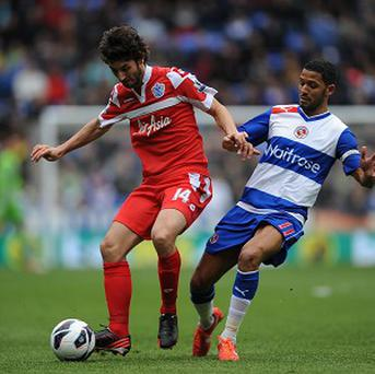 QPR's Esteban Granero, left, and Reading's Jobi McAnuff battled for the ball during the goalless draw