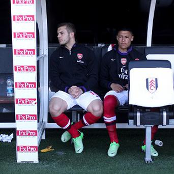 Alex Oxlade-Chamberlain, right, has made only 11 starts in the Barclays Premier League this term