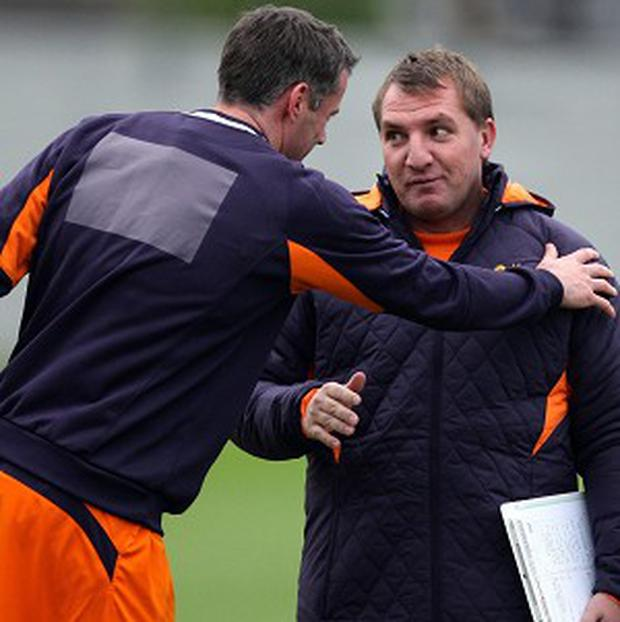 Brendan Rodgers, right, will miss the presence of Jamie Carragher, left, next season