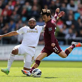 Ashley Williams, left, and David Silva battled for the ball as Swansea and Manchester City played out a goalless draw