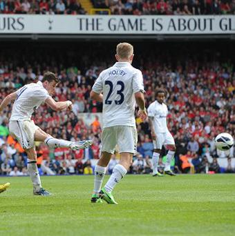 Gareth Bale, centre, struck late on to hand Tottenham three points
