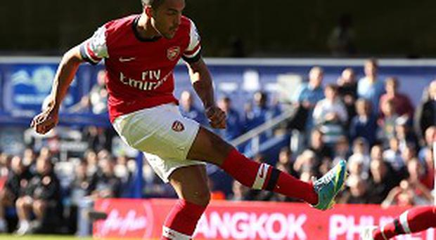 Theo Walcott, left, scored after less than a minute at Loftus Road