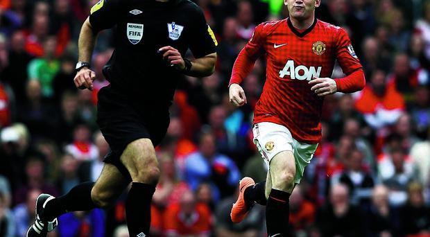 Manchester United's Wayne Rooney shouts at referee Howard Webb following an incident in the build-up to Chelsea's winning goal