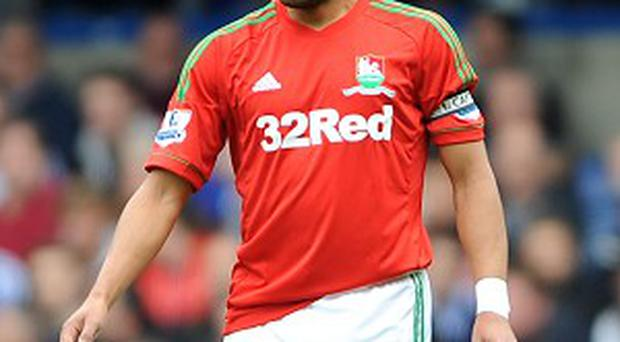 Ashley Williams has dismissed suggestions Swansea have given up on their season
