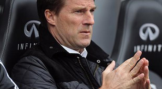 Michael Laudrup is expecting a tough encounter against Wigan