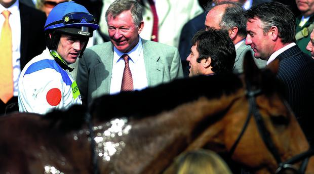 Sir Alex Ferguson congratulates jockey Ruby Walsh after victory on What A Friend at Aintree in 2010