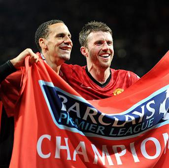 Rio Ferdinand, left, and Michael Carrick, right, are happy with the appointment of David Moyes