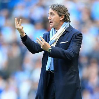 Roberto Mancini said he is honoured to have had the chance to face Sir Alex Ferguson