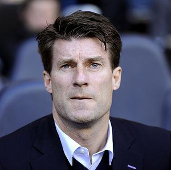 Michael Laudrup has reiterated his desire to stay at Swansea