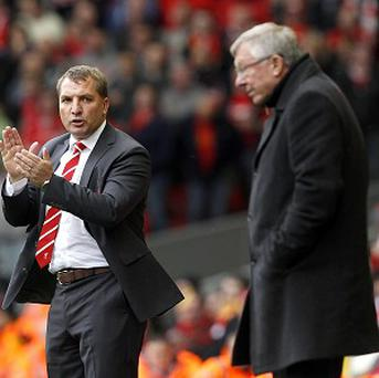 Brendan Rodgers, left, believes Sir Alex Ferguson's, right, retirement could help Liverpool
