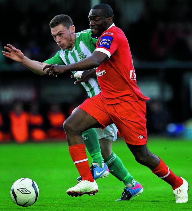 Sligo's Joseph N'do battles it out with John Mulroy at the Carlisle Grounds