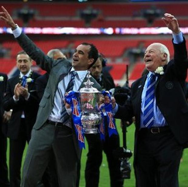 Dave Whelan, right, believes Roberto Martinez will stay at Wigan