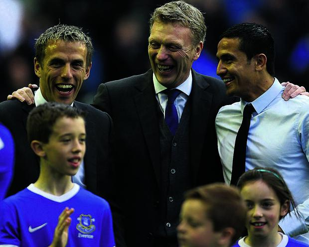 Everton manager David Moyes (centre) laughs with Phil Neville and former player Tim Cahill (right) during the lap of honour after the Barclays Premier League match at Goodison Park