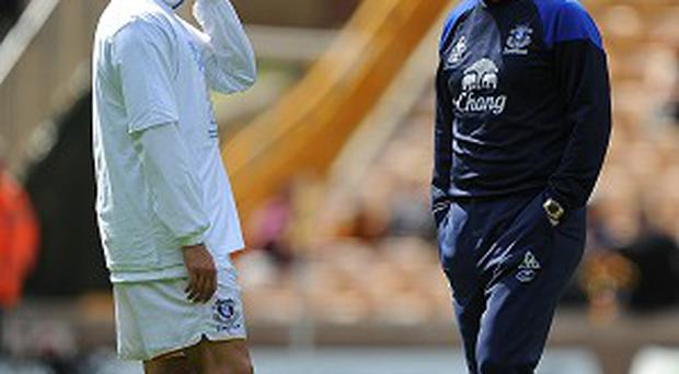 Phil Jagielka, left, has heaped praise on outgoing Everton boss David Moyes, right