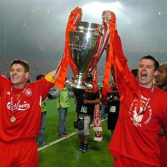 Jamie Carragher, right, says the highlight of his Liverpool career was winning the Champions League