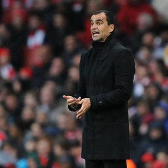 Roberto Martinez, pictured, is favourite to replace David Moyes at Everton