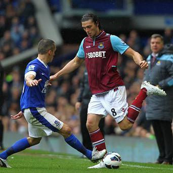 Andy Carroll, right, has been in fine form for West Ham this season