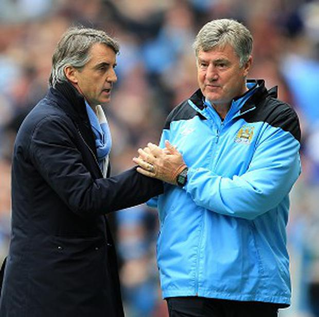 Roberto Mancini, left, won the FA Cup in 2011 and topped that by winning the title last year