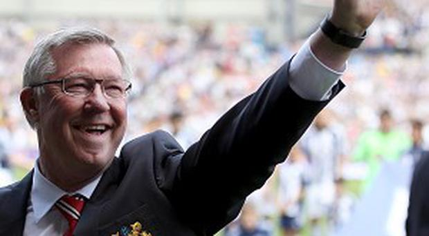 Sir Alex Ferguson waves to the crowd prior to his last match in charge
