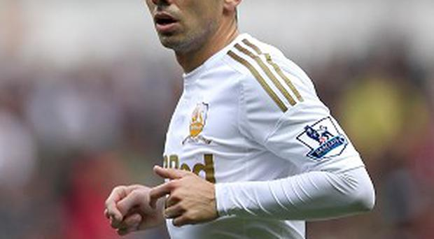Leon Britton is set to travel to Germany for a double hernia operation next month