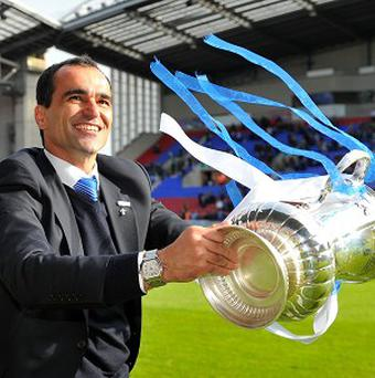 Roberto Martinez, pictured, held further talks with Wigan chairman Dave Whelan on Thursday