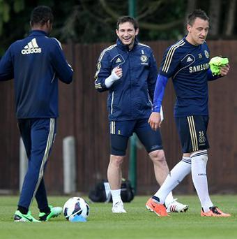 Frank Lampard, centre, wants John Terry to remain at Chelsea