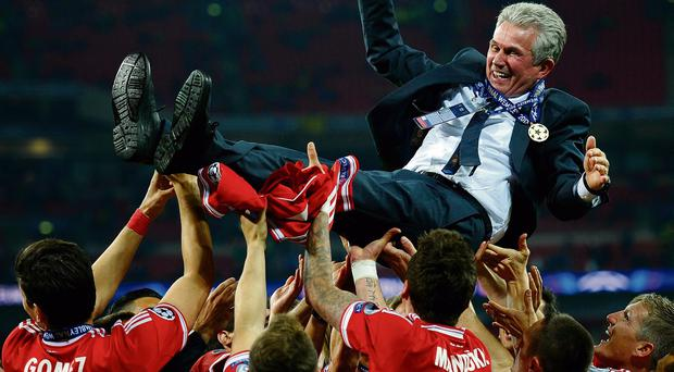 Head coach Jupp Heynckes is thrown into the air by Bayern Munich players after winning the UEFA Champions League final last night.