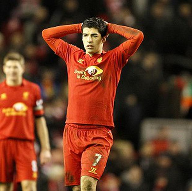 Luis Suarez says Liverpool is a 'fantastic club' but has not ruled out moving on