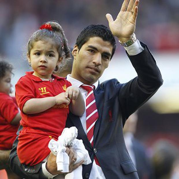 Luis Suarez admits the negative press is affecting his family