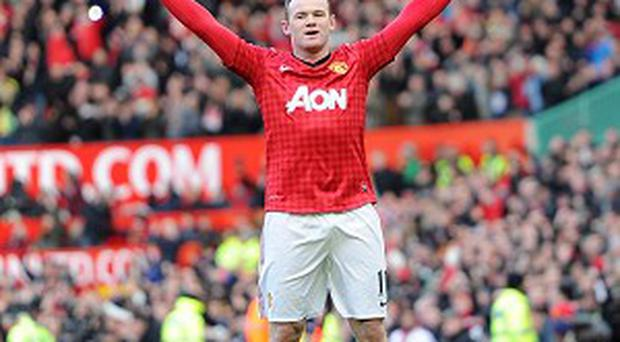 Wayne Rooney, pictured, has been tipped to stay at Manchester United
