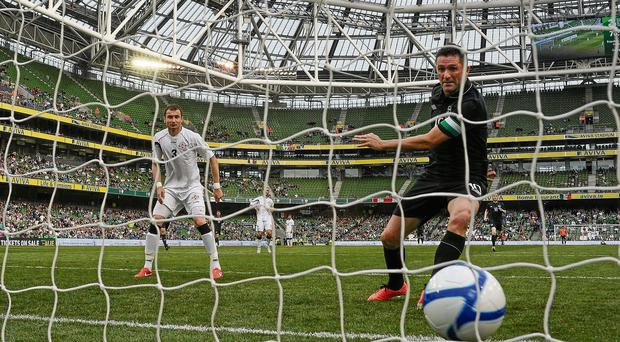 Robbie Keane bundles the ball over the line for Ireland's third goal in the 4-0 victory over Georgia last night - Keane added a second to take his total to a record-breaking 56 in 125 internatonal games