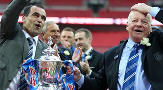 Dave Whelan, right, knows Roberto Martinez, left, may try and take some Wigan players to Everton
