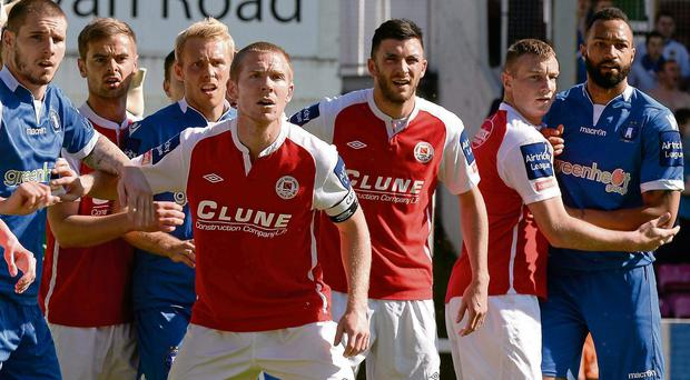 Concentration is the name of the game for both sets of players as St Patrick's Athletic prepare to defend a corner kick at Richmond Park