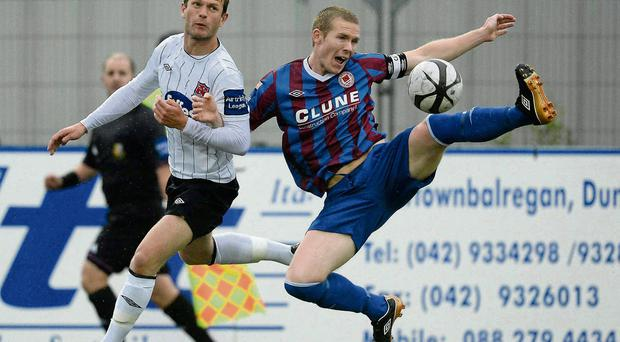 Dundalk's Dane Massey tangles with Conor Kenna of St Pat's in their clash at Oriel Park last night
