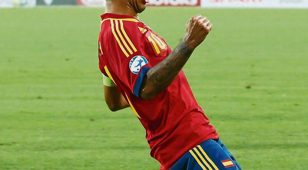 Thiago Alcantara celebrates after scoring for Spain