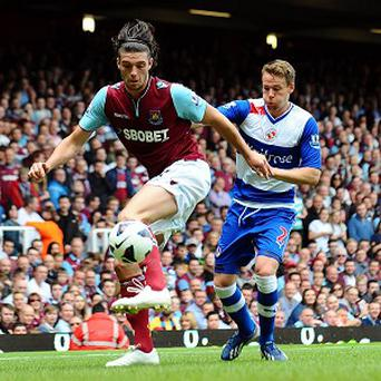 Andy Carroll, left, has penned a six-year deal with West Ham