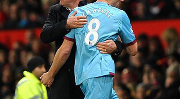Sam Allardyce, left, believes Andy Carroll, right, will improve further after signing permanently for West Ham