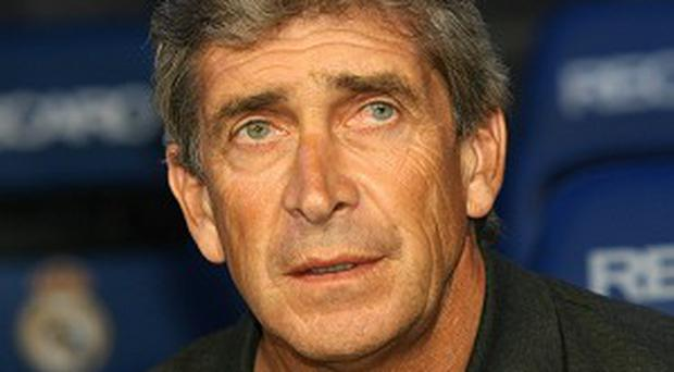 Manuel Pellegrini's Manchester City are heading to South Africa