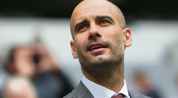 Josep Guardiola visits the Allianz Arena on his first day as Bayern Munich head coach