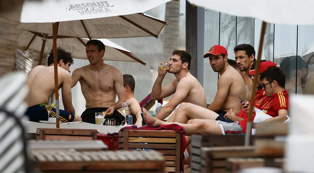Iker Casillas (centre) enjoys a drink as he relaxes with team-mates Javi Martinez, Ignacio Monrea, Santiago Cazorla, Jesus Navas and David Villa at the Playa Futuro in Fortaleza